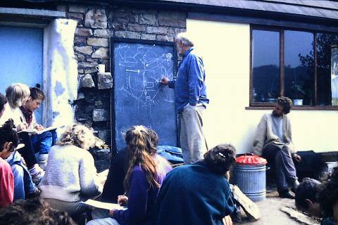 Bill Mollison teaching at Ragman's Lane Farm, chalk in hand, a story and a smile.